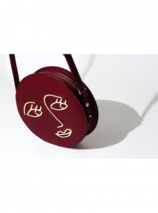 Young British Designers: LOVE Circle Bag in Burgundy Leather by Paradise Row