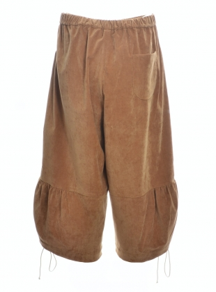 Young British Designers: JOE SOFTEST CAMEL VELVET TROUSERS by Renli Su