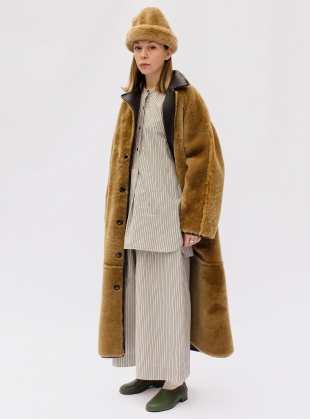 Young British Designers: ANNIE REVERSIBLE SHEEPSKIN COAT. Chocolate/Tan by Cawley