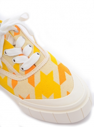 Young British Designers: OPAL DOGSTOOTH. Yellow. by Good News
